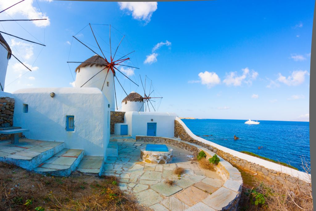 Panoramic view of two windmills and their bases Mykonos Greece Cyclades